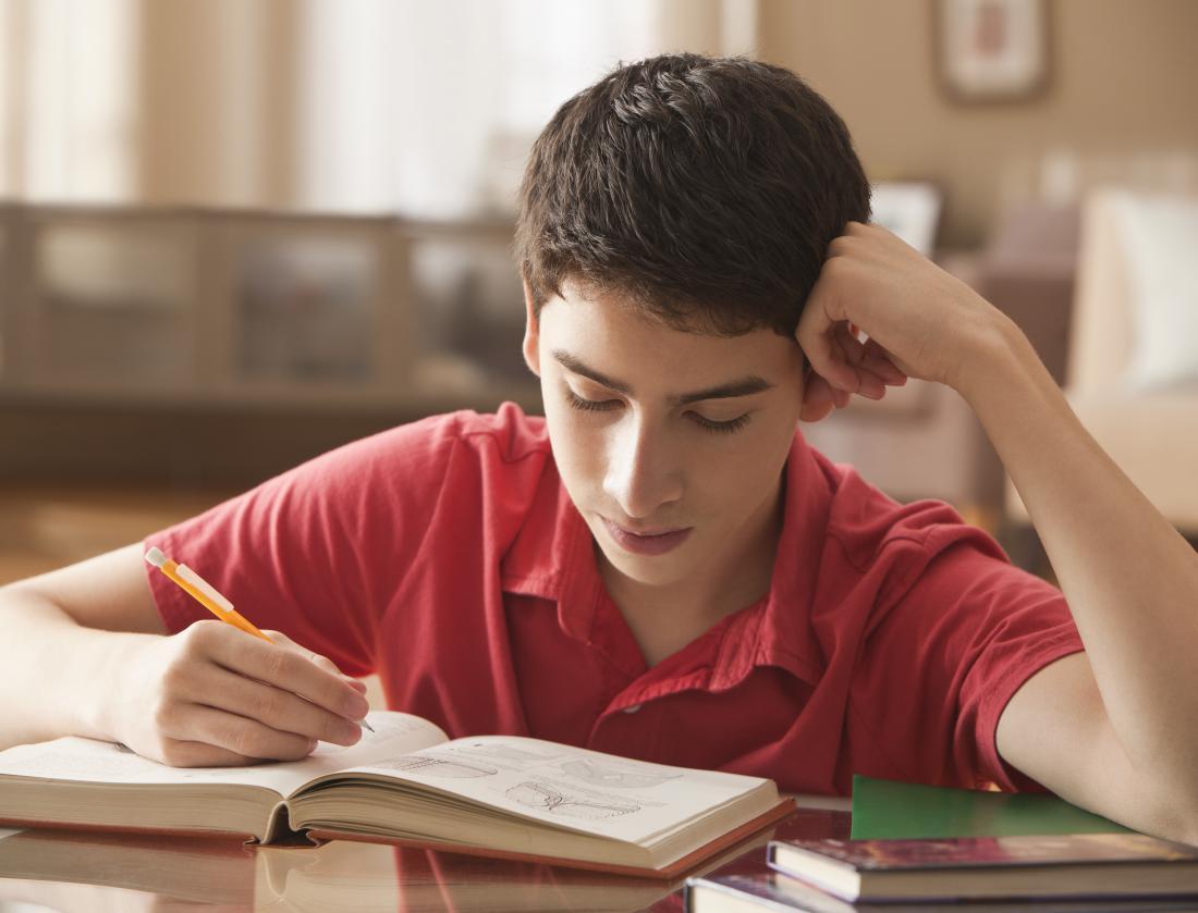 Hispanic boy studying at desk
